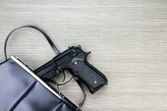 Free Woman Bag With Gun Hidden, Handgun Falling From A Woman`s Purse. Stock Image - 92516001