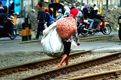 Woman with baggage on railway in Jav, Indonesia Royalty Free Stock Photography