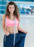 Woman in baggy pants Stock Images