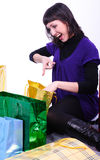 Woman with bags. The beautiful young woman sits among bags Royalty Free Stock Photos