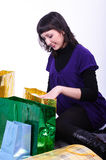 Woman with bags. The beautiful young woman sits among bags Stock Photo