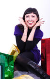 Woman with bags. The beautiful young woman sits among bags Royalty Free Stock Photography