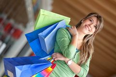 Woman with bags Royalty Free Stock Photos