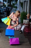 Woman with Bags. Pregnant woman struggling with multiple shopping bags royalty free stock images