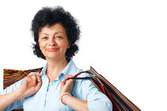 Woman with Bags. Close up portrait of elder woman with shopping bags Stock Photos