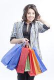 Woman with bags. Woman with shopping bags on white background smiling Royalty Free Stock Photos