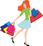 Woman with bags. Red-haired young woman with colour bags Stock Images