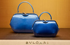 Woman bags Bulgari. Bulgari (Italian pronunciation: [ˈbulɡari]) is an Italian jewelry and luxury goods company. The trademark is usually written BVLGARI in the Royalty Free Stock Images