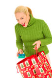 Woman with bags with Christmas gifts. On the white backgroud Stock Images
