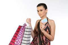 Woman with  bags and credit card. Beautiful teenage girl with shopping bags and credit card Stock Photos