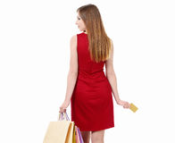 Woman with bags and credit card Royalty Free Stock Photography