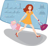 Woman with bags near the shop. Woman in a short dress and high-heeled shoes with bags near the shop Stock Photography