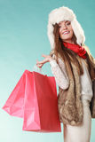 Woman with bags shopping. Winter fashion. Royalty Free Stock Images