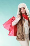 Woman with bags shopping. Winter fashion. Royalty Free Stock Photos