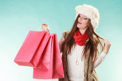 Woman with bags shopping. Winter fashion. Royalty Free Stock Photo