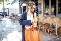 Woman with baguette in the city Royalty Free Stock Photos