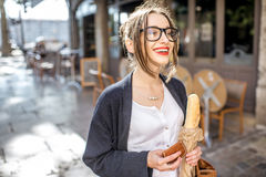 Woman with baguette in the city Royalty Free Stock Image