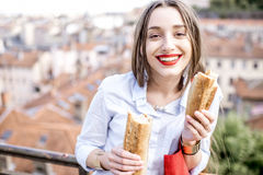 Woman with baguette in Lyon Royalty Free Stock Image