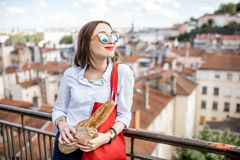 Woman with baguette in Lyon Stock Photography