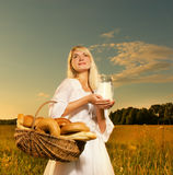Woman with a baked bread Royalty Free Stock Photo