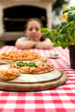 Woman with baked pizza Royalty Free Stock Photos