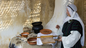 Woman in bakery. At Biblical Village. The Biblical Village is the first project in Europe organized in Bucharest at Titan Park and represents historical re stock image