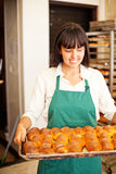 Woman in bakery Royalty Free Stock Image