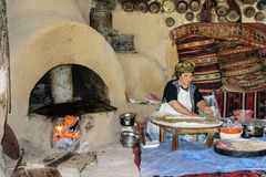 The woman bakes bread in the old days. Royalty Free Stock Photos