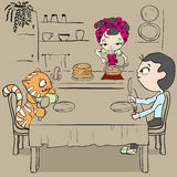 Woman bakes pancakes. Cat and man waiting for dinner Royalty Free Stock Photography