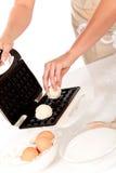 Woman baking Belgium waffles Stock Images
