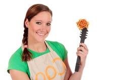 Woman baking Belgium waffles Stock Photo