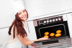 Woman baking bread Stock Photography