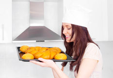 Woman baking bread Stock Photos