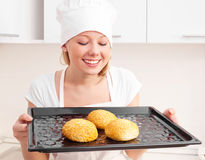 Woman baking bread Stock Image