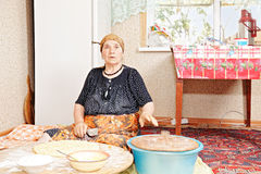 Woman baking bread Royalty Free Stock Image