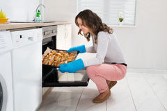 Woman Baking Bread Roll Stock Image