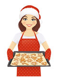 Woman baking christmas cookies. Smiling woman holding baking tray with christmas cookies wearing santa hat isolated vector illustration