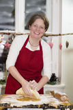 Woman is baking cookie Royalty Free Stock Photography