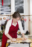 Woman is baking cookie Royalty Free Stock Photo