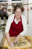 Woman is baking cookie Stock Photography
