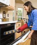 Woman baking cookies. Royalty Free Stock Image