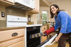 Woman baking cookies. royalty free stock photos