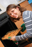 Woman baking cookies Royalty Free Stock Image