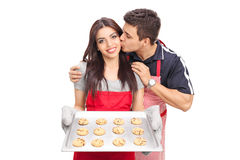 Woman baking cookies with her boyfriend Royalty Free Stock Image