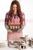 Woman baking cookies in the kitchen Royalty Free Stock Photos