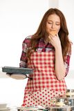 Woman baking cookies in the kitchen.  Royalty Free Stock Image