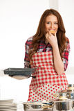 Woman baking cookies in the kitchen Stock Photography