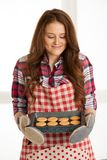 Woman baking cookies in the kitchen.  Royalty Free Stock Photos