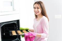 Woman baking cookies Stock Image
