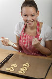 Woman baking. Cookies at a tabler Stock Photo